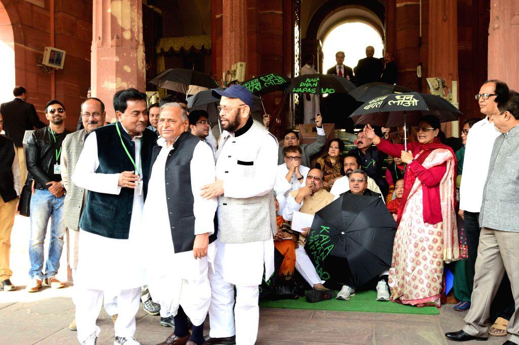 Samajwadi Party supremo Mulayam Singh Yadav joins Trinamool Congress MPs demonstrating against the issue of black money in the Parliament premises on Nov 25, 2014. - Mulayam Singh Yadav
