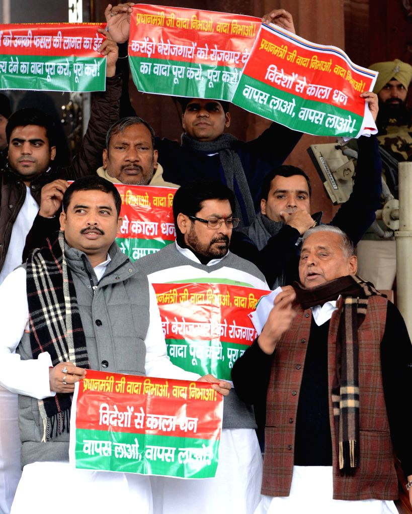Samajwadi Party supremo Mulayam Singh Yadav and others stage a protest against Narendra Modi led Union Government at the Parliament House, in New Delhi on Dec 22,2014. - Mulayam Singh Yadav