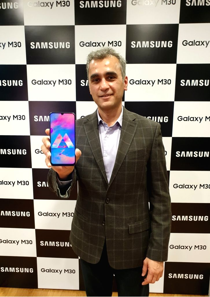 New Delhi: Samsung India Senior Vice-President Asim Warsi at the launch of Galaxy M30 smartphone in New Delhi, on Feb 28, 2019. (Photo: IANS)