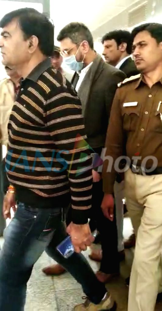 New Delhi: Sanjeev Chawla, the alleged mastermind of match-fixing case being accompanied by a crime branch team from London arrives at Indira Gandhi International Airport on Feb 13, 2020. (Photo: Sanjeev Kumar Singh Chauhan/IANS)