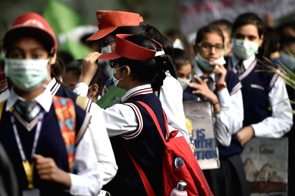 New Delhi: School students wearing masks participate in an awareness march on rising pollution levels in New Delhi on Nov 15, 2017. (Photo: IANS)