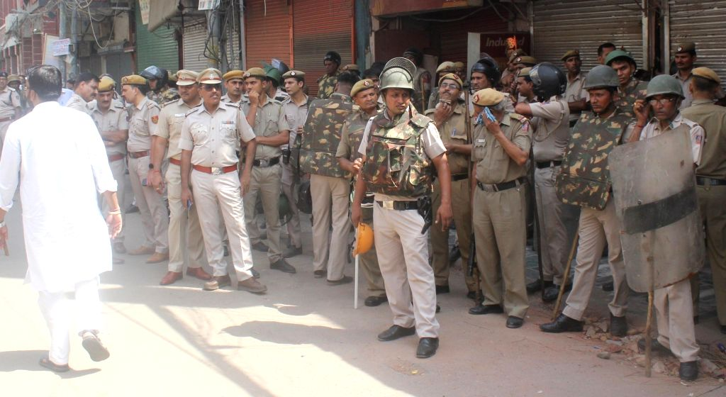 New Delhi: Security beefed up in Central Delhi's Hauz Qazi area where a minor scuffle over parking of a scooty took a communal turn following violent clashes that broke out late on Sunday night; on July 2, 2019. The situation in the area remained ten