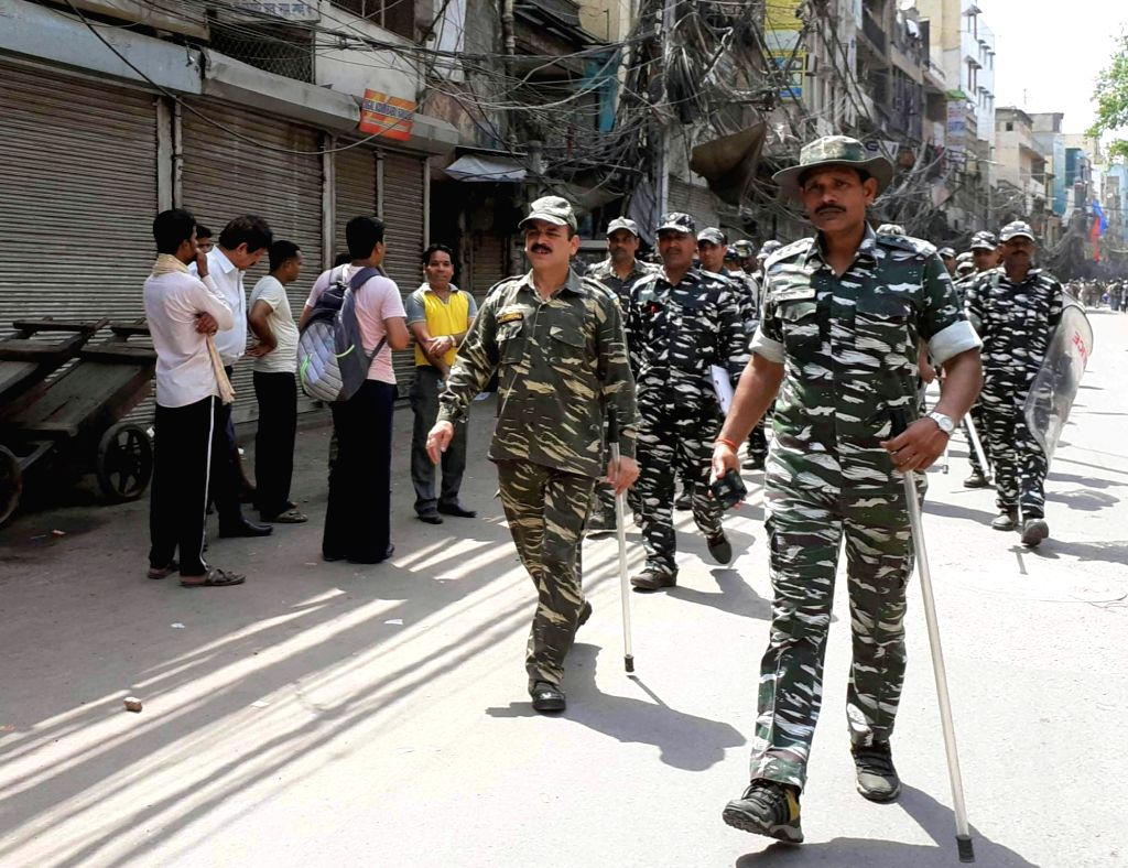 New Delhi: Security personnel conduct route march after clashes broke out between the people of two communities over a parking issue in Delhi's Hauz Qazi area, on July 1, 2019. The police have taken control of the area and are mediating to ensure cor