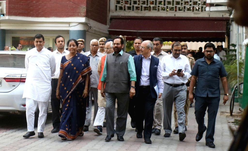 New Delhi: Senior BJP leaders Nirmala Sitharaman, Mukhtar Abbas Naqvi and others outside Election Commissioner's office after meeting Chief Election Commissioner (CEC), in New Delhi, on April 12, 2019. (Photo: IANS)