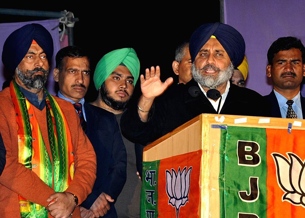 Shiromani Akali Dal President Sukhbir Singh Badal campaigns in favor of Harmeet Singh Kalka, SAD-BJP candidate from Kalkaji assembly constituency, at Gobindpuri in Kalkaji, in New Delhi on