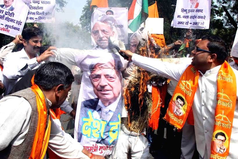 Shiv Sena activists stage a demonstration against Jammu and Kashmir Chief Minister Mufti Mohammad Sayeed in New Delhi, on March 12, 2015. - Mufti Mohammad Sayeed