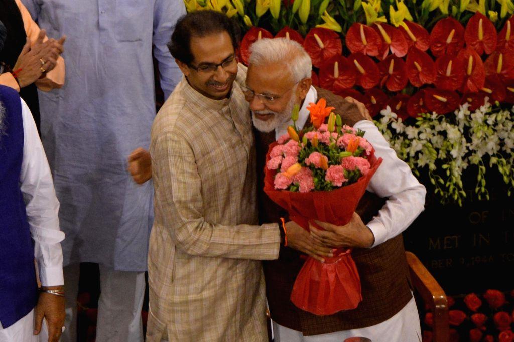 New Delhi: Shiv Sena president Uddhav Thackeray greets Prime Minister Narendra Modi during NDA Parliamentary Board meeting at the Central Hall of Parliament, in New Delhi on May 25, 2019. (Photo: IANS) - Narendra Modi
