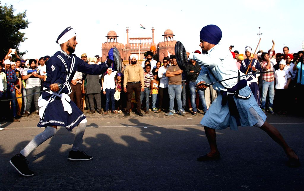 Sikh people showing dare davils on 'Fateh Divas' at Red Fort in New Delhi on March 22, 2015. (Photo : IANS)