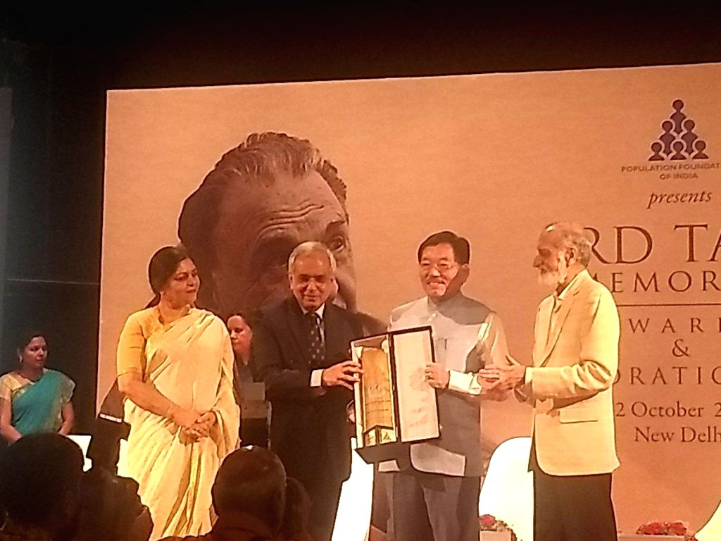 :New Delhi: Sikkim Chief Minister Pawan Chamling receives the JRD Tata Memorial Awards for Sikkim as the best performing high focus north eastern state; in New Delhi on Oct 12, 2018. (Photo: ...