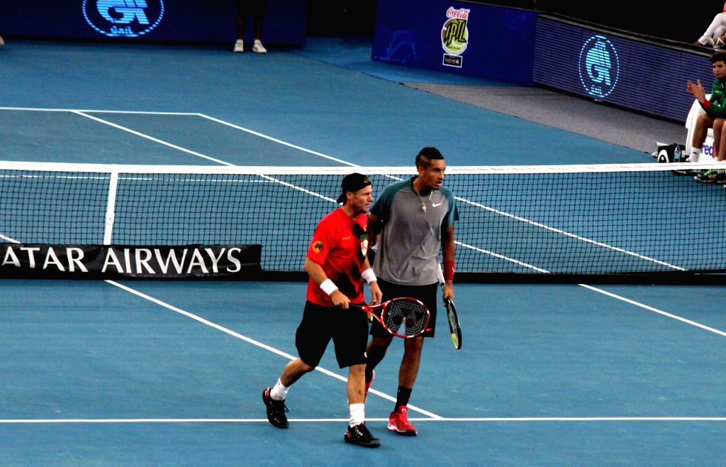 Singapore Slammers Lleyton Hewitt and Nick Kyrgios in action during their doubles match against UAE Royals Marin Cilic and Nenad Zimonjic on the Coca-Cola International Premier Tennis ...