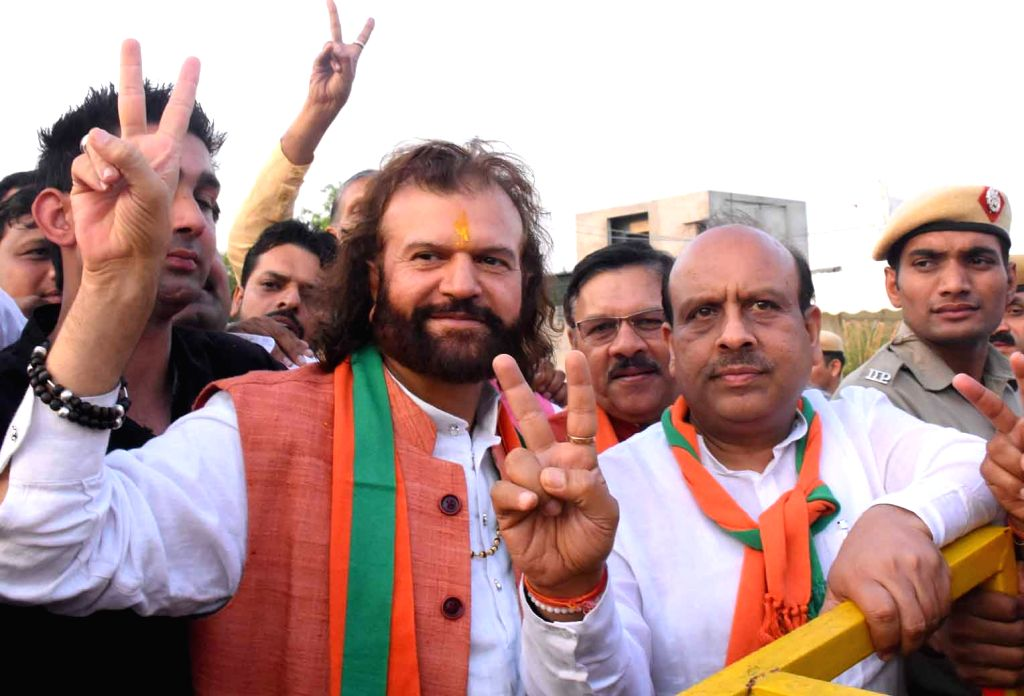 New Delhi : Singer-turned-politician, BJP Lok Sabha candidate from North West Delhi, Hans Raj Hans shows victory sign after filing his nomination for the 2019 Lok Sabha elections, in New Delhi on April 23, 2019. (Photo: IANS)