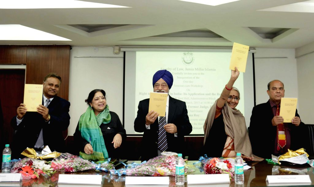 Social activist Aruna Roy and other dignitaries at the launch of  `The Indian Journal Of Law & Public Policy` at Jamia Millia Islamia in New Delhi, on March 2, 2015. - Aruna Roy