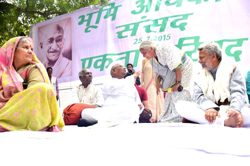Social activists Anna Hazare, Medha Patkar and others during a demonstration to protest against the land acquisition ordinance at Jantar Mantar in New Delhi on Feb 25, 2015.