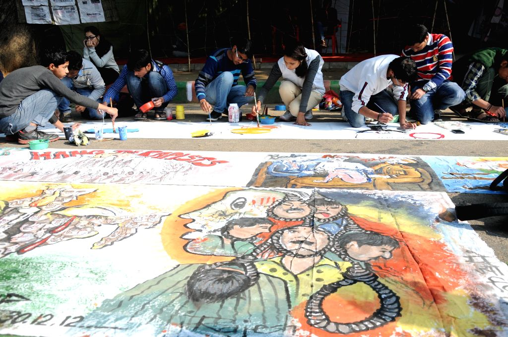 New Delhi: Social activists paint pictures to condemn 2012 Nirbhaya gangrape the  at Jantar Mantar in New Delhi on Dec 16, 2014. (Photo: IANS)