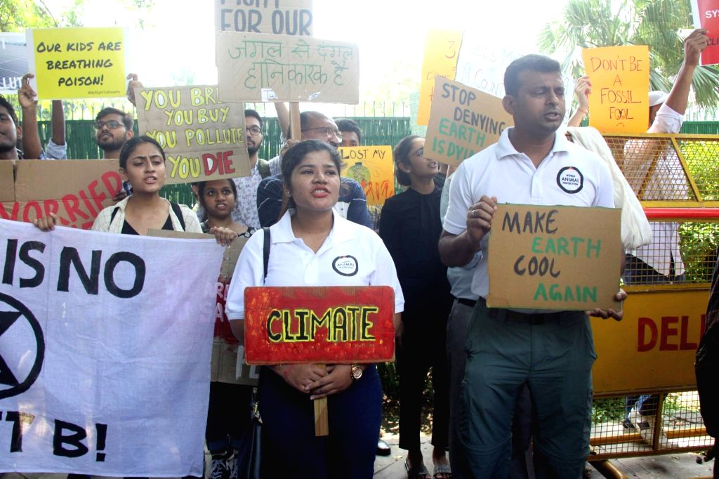 New Delhi: Social activists participate in 'global climate strike' - a week-long campaign to draw people's attention towards the climate emergency, in New Delhi on Sep 20, 2019. (Photo: IANS)