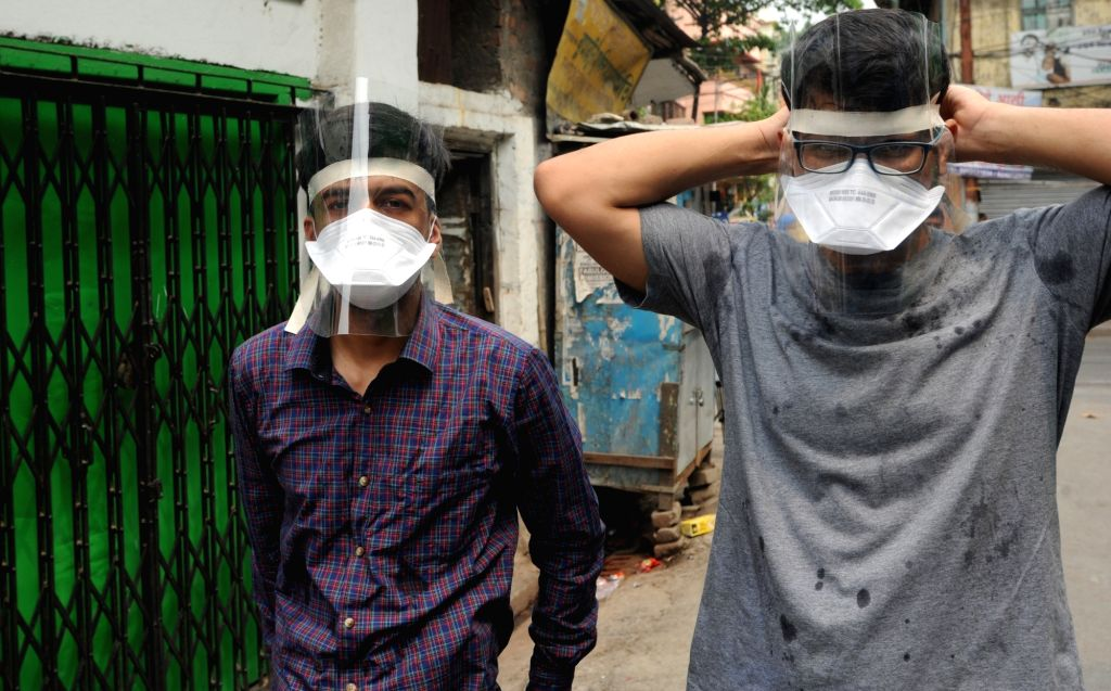 New Delhi: South Asian Medical Students' Association (SAMSA) members demonstrate how to wear N95 Masks and Face Shields ahead of distributing them at various Medical Colleges of Kolkata free of cost during the extended nationwide lockdown imposed to