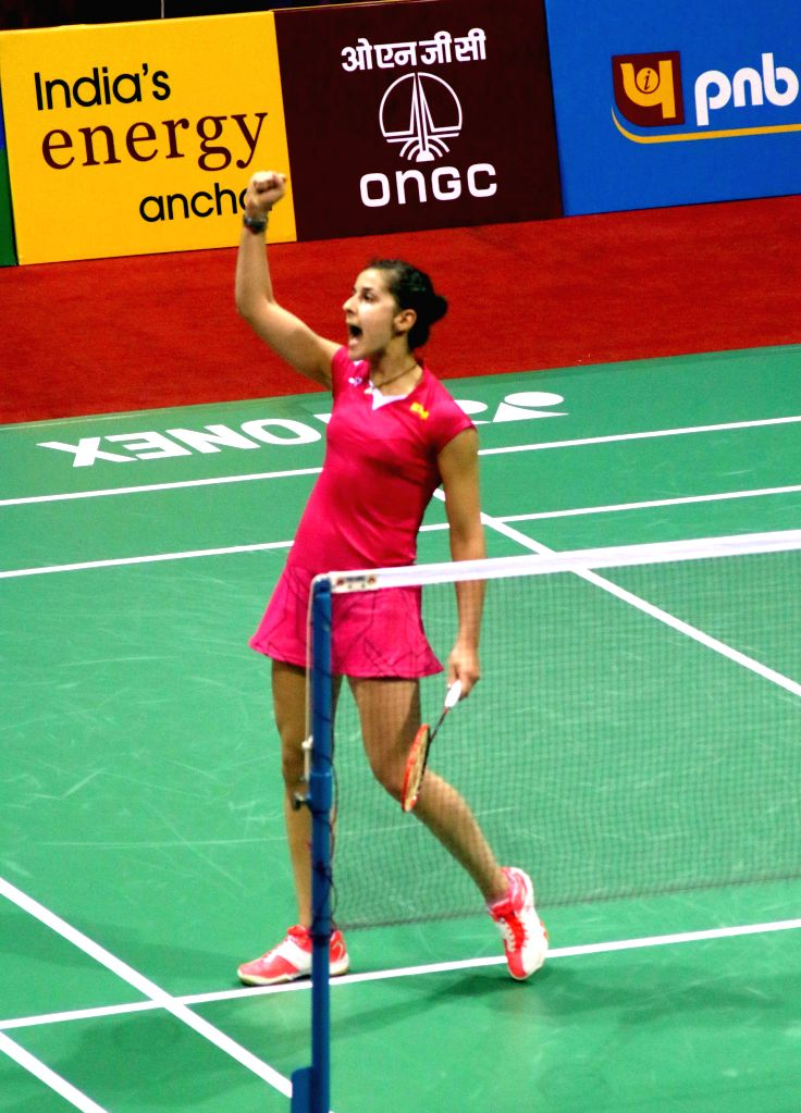 Spanish badminton player Carolina Marin reacts during a Yonex Sunrise Indian Open Badminton Championship  match against Nozomi Okuhara of Japan in New Delhi on March 27, 2015.