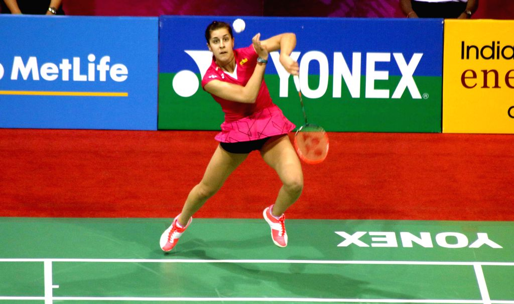 Spanish badminton player Carolina Marin returns a shot to Nozomi Okuhara of Japan during a women`s singles match of Yonex Sunrise Indian Open Badminton Championship in New Delhi on March ...