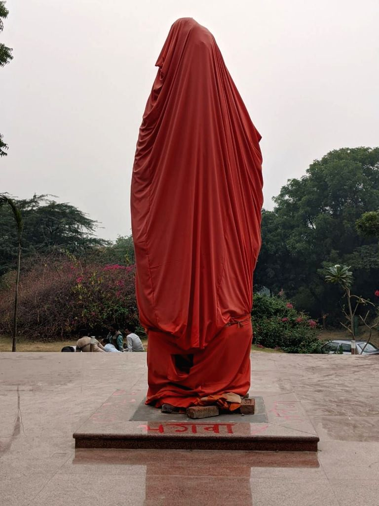 New Delhi: Statue of Swami Vivekananda -yet to be unveiled- vandalised in JNU campus, New Delhi on Nov 14, 2019. (Photo: IANS)