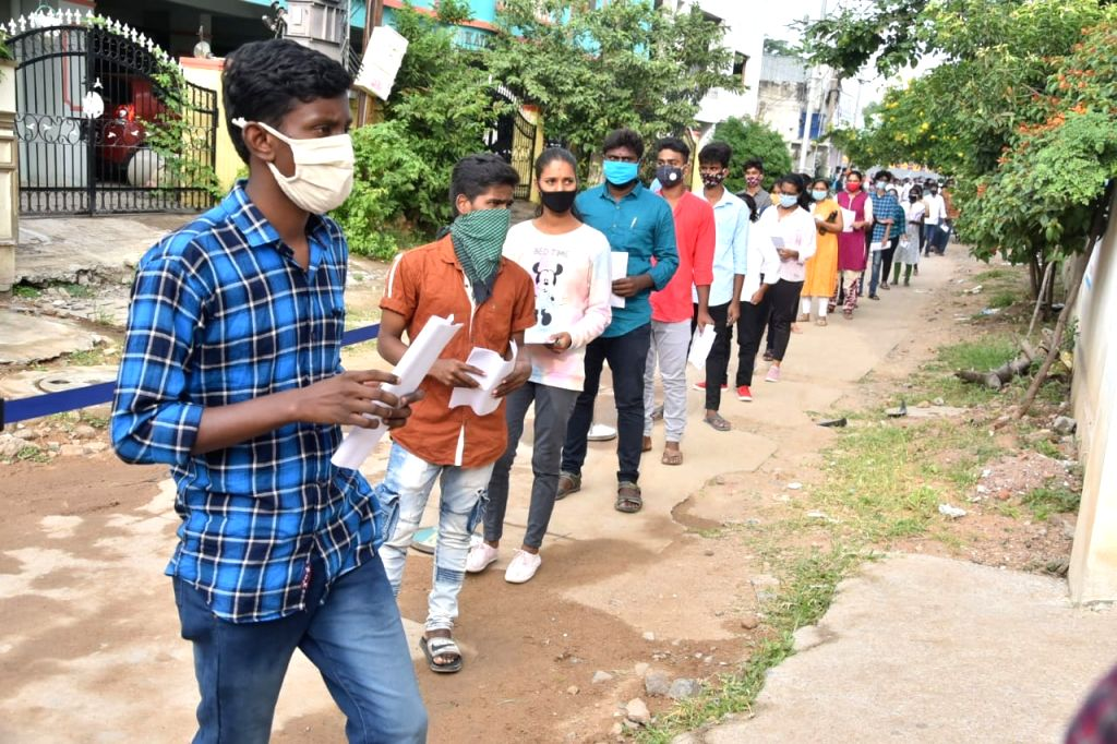 New Delhi: Students appearing  for the Telangana State Engineering, Agriculture & Medical (Pharmacy, Veterinary) Common Entrance Test follow social distancing as they queue up outside their examination center in Hyderabad on Sep 9, 2020. All Covid-19