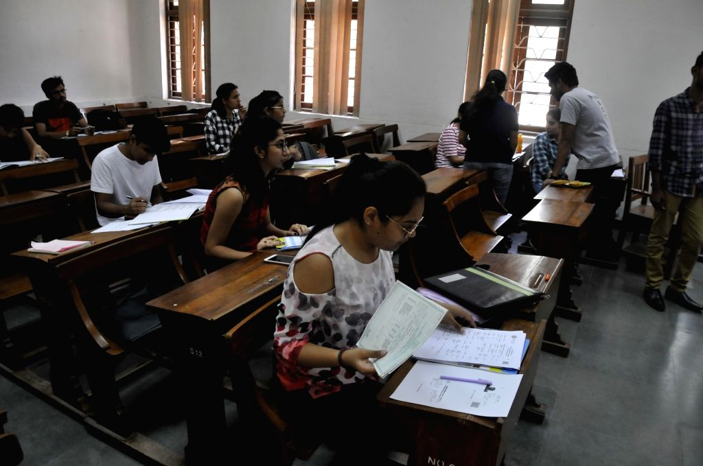 New Delhi: Students at Delhi University (DU) after first cut-off list of the University was released on June 19, 2018. (Photo: IANS)
