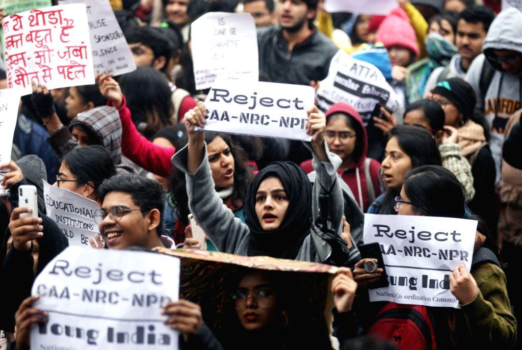 New Delhi: Students of Delhi University stage a demonstration against fee hike, CAA, NRC, NPR in New Delhi on Jan 8, 2020. (Photo: IANS)