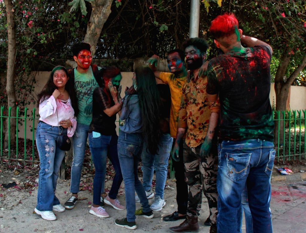 New Delhi:Students of YMCA college celebrate Holi on the eve of Holi Festival in new Delhi on Saturday March 27, 2021.