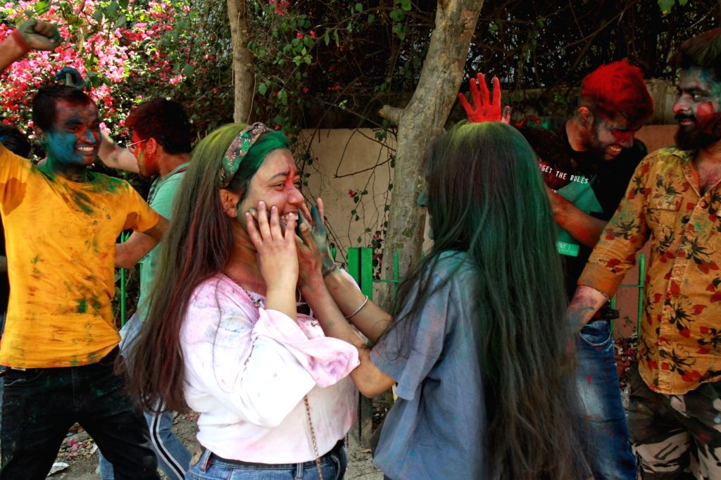 New Delhi:Students of YMCA college celebrate Holi on the eve of Holi Festival in new Delhi on Saturday March 27, 2021.(Photo: Wasim sarvar/IANS)