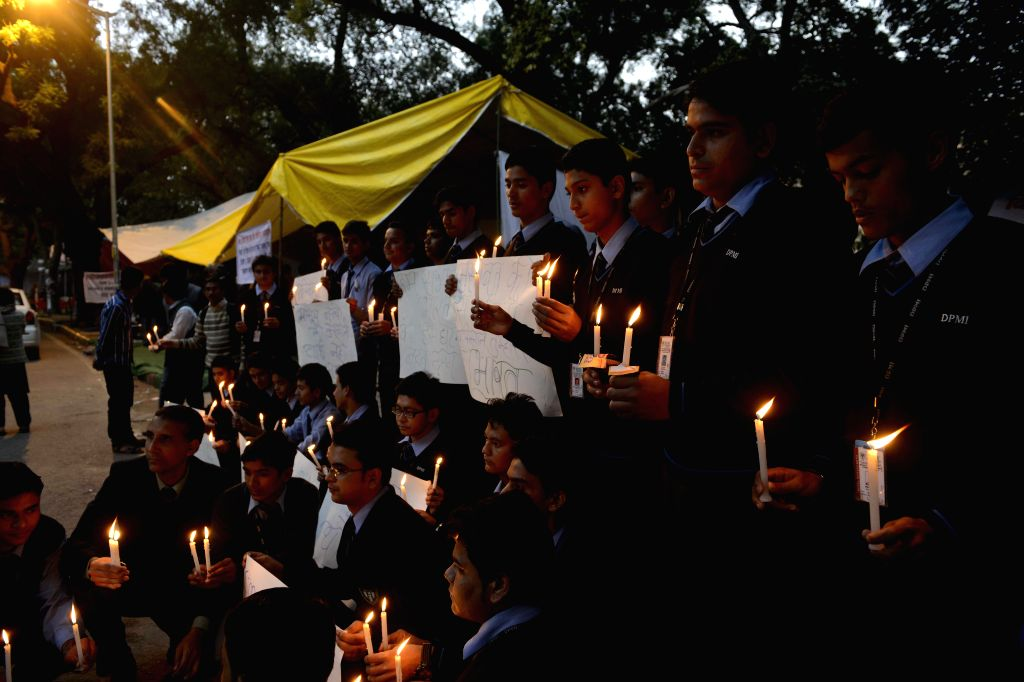 Students participate in a candle light vigil to protest against Tuesday's attack on the Army Public School in Peshawar, Pakistan, that claimed 104 lives mostly those of children, in New ...