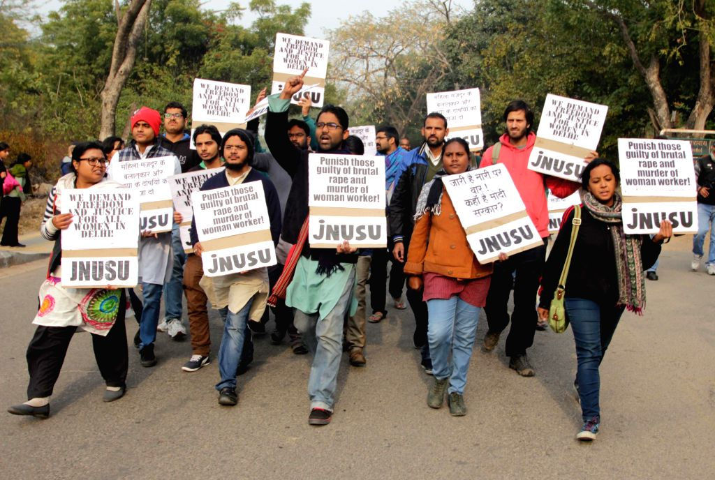 Students participate in a rally organised against violence against women at JNU Campus in New Delhi, on Jan 11, 2015.