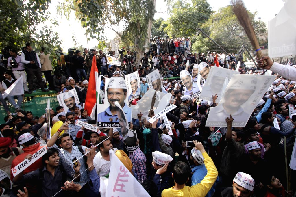 Supporters of Aam Aadmi Party (AAP) celebrate party`s performance in the recently concluded Delhi Assembly Polls at Patel Nagar in New Delhi, on Feb 10, 2015.