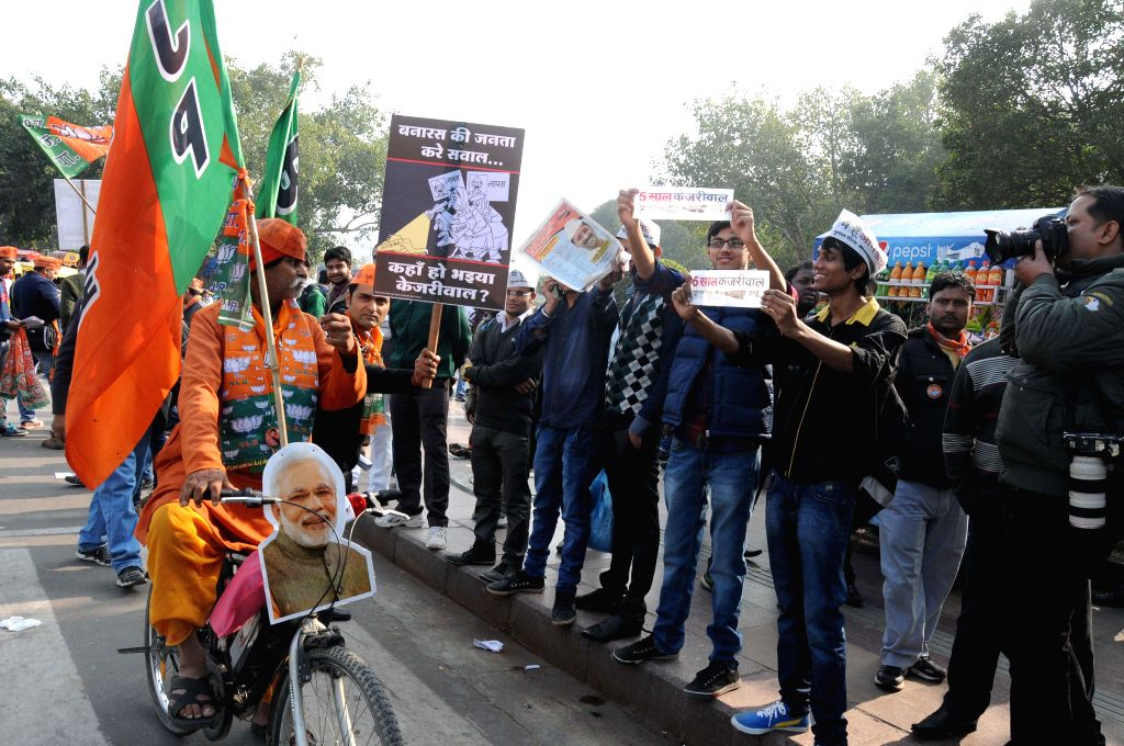 Supporters of Aam Aadmi Party (AAP) and Bharatiya Janata Party (BJP) came face to face during a rally for the upcoming Delhi Assembly Election in New Delhi on Feb. 4, 2015.