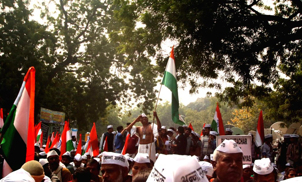 Supporters of social activist Anna Hazare participate in a protest against the land ordinance passed by the NDA government at Jantar Mantar in New Delhi.