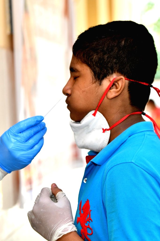 New Delhi: Swab samples being collected for COVID-19 testing at a coronavirus testing centre in New Delhi on June 24, 2020. (Photo: IANS)