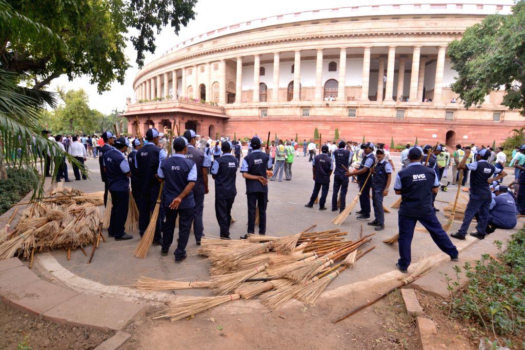 New Delhi: 'Swachhata Abhiyaan' (cleanliness drive) organised by Lok Sabha Speaker Om Birla underway at Parliament, in New Delhi on July 13, 2019. (Photo: IANS) - O
