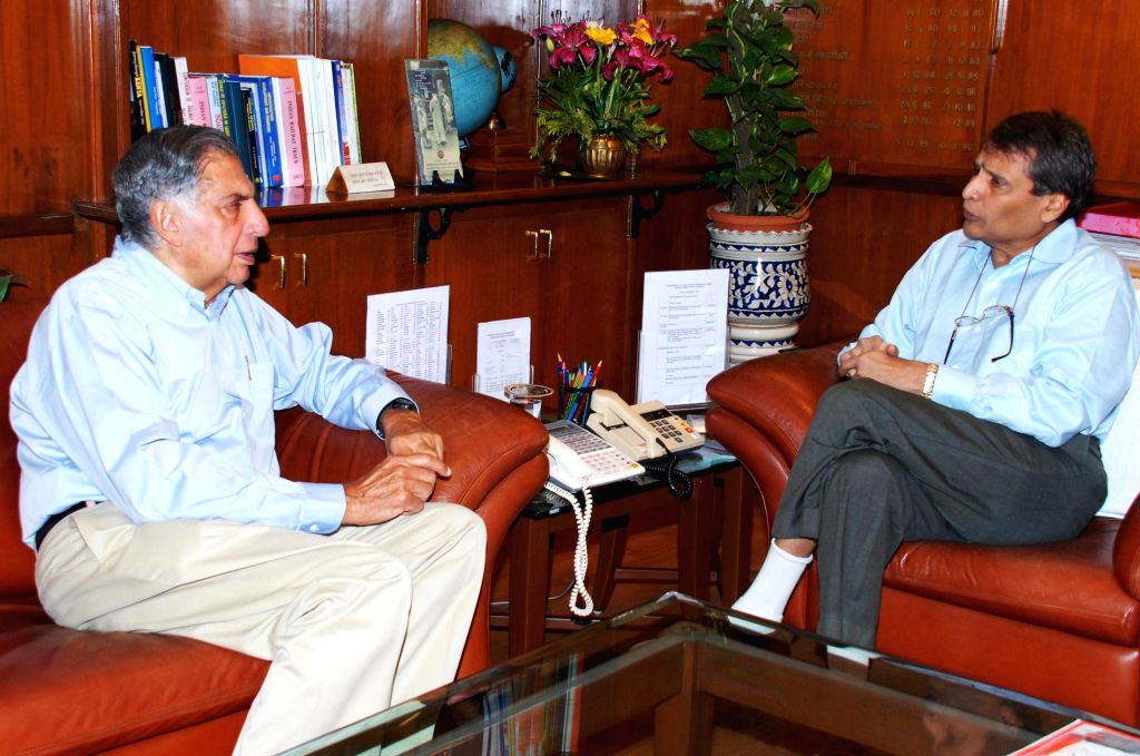 Tata Group Chairman Ratan Tata calls on the Union Minister for Railways Suresh Prabhakar Prabhu, in New Delhi on March 13, 2015.