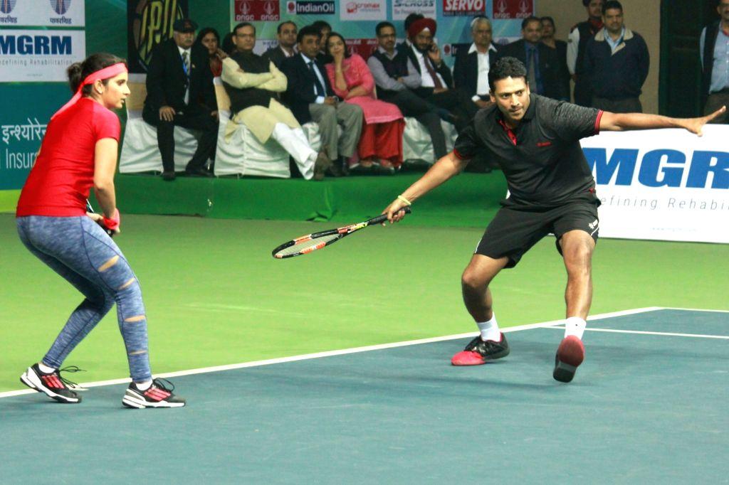 New Delhi: Tennis player Mahesh Bhupathi and Sania Mirza during an exhibition match in New Delhi on Nov 27, 2015. (Photo: Amlan Paliwal/IANS) - Mahesh Bhupathi and Sania Mirza