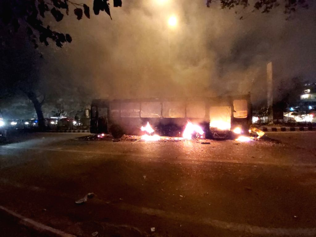 New Delhi: The charred remains of a bus that was set ablaze by unknown miscreants during a protest against the Citizenship (Amendment) Act, 2019 and National Register of Citizens (NRC) in New Delhi on Dec 15, 2019. (Photo: IANS)
