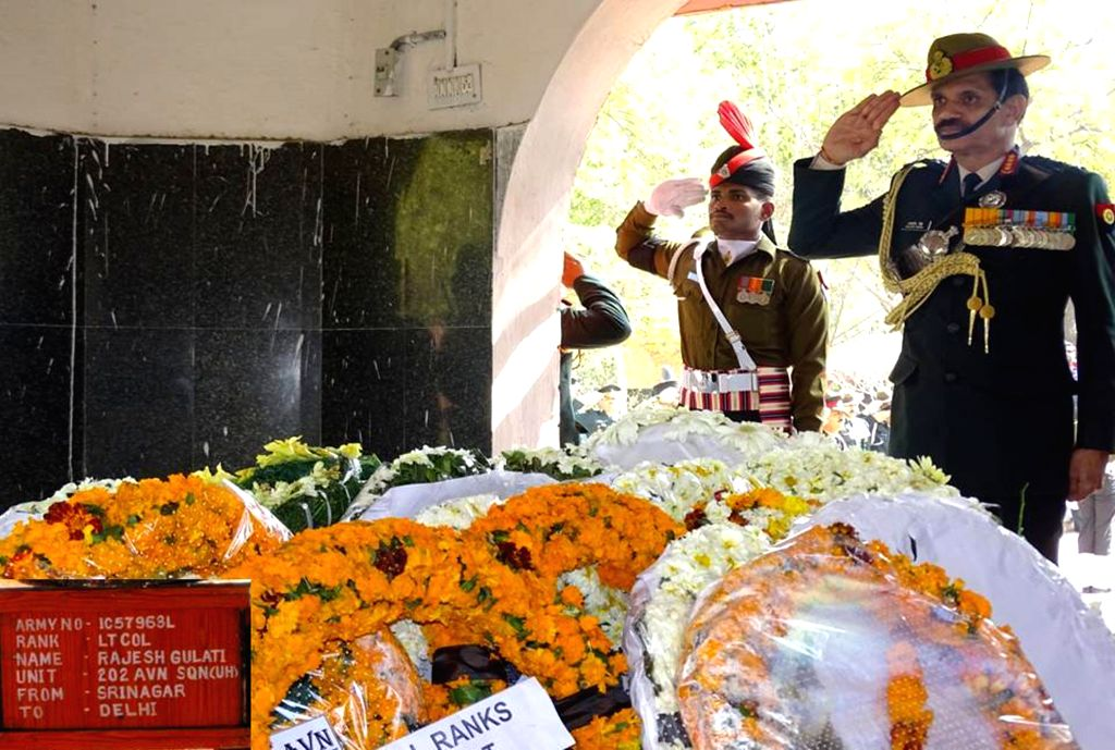 The Chief of Army Staff, General Dalbir Singh pays tribute to Lt. Col Rajesh Gulati prior to his cremation, in New Delhi on Feb 13, 2015. Gulati was killed in an Advanced Light Helicopter .