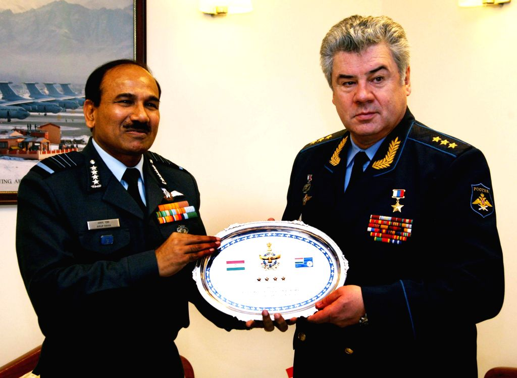 The Chief of the Air Staff, Chairman COSC, Air Chief Marshal Arup Raha presents a memento to the Commander in Chief of Russian Federation Air Force (RFAF) Col. Gen. Viktor Nikolaevich ...