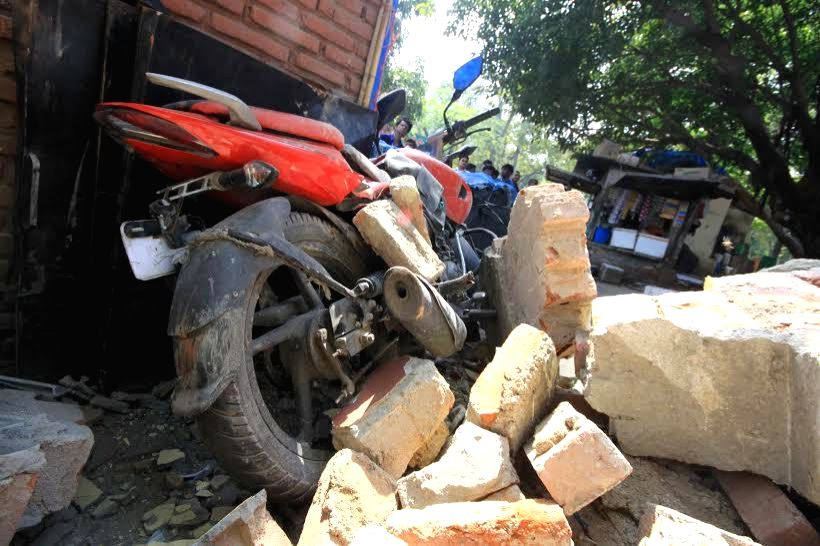 The debris of the Gole market Kendriya Vidyalaya wall that collapsed in New Delhi, on March 12, 2015.