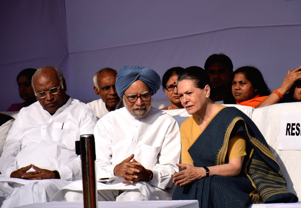 The leader of the Congress parliamentary party in Lok Sabha Mallikarjun Kharge, former prime minister, Dr. Manmohan Singh and Congress chief Sonia Gandhi pay tribute to Dr. B.R. Ambedkar ... - Manmohan Singh and Sonia Gandhi