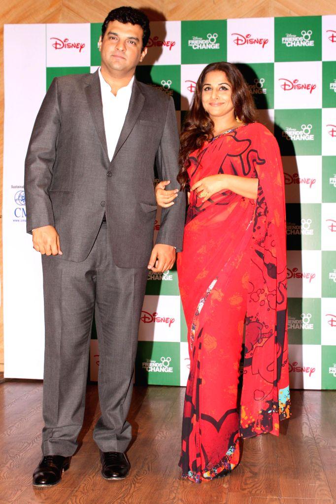 New Delhi: The MD of Studios, Disney UTV, Siddharth Roy Kapur with actress and his wife Vidya Balan during `Friends For Change` - an innovative inter-school volunteering program in New Delhi on Feb 25, 2015. (Photo: Amlan Paliwal/IANS) - Vidya Balan and Siddharth Roy Kapur