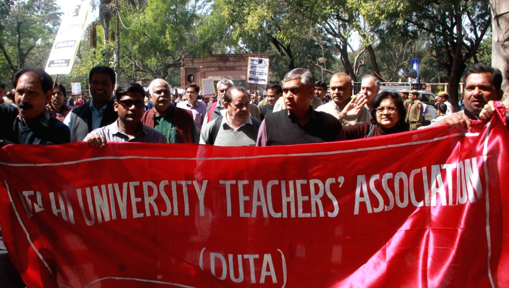 The members of Delhi University Teachers' Association stage a demonstration against the vice chancellor at the North Campus of the University in New Delhi, on March 10, 2015.