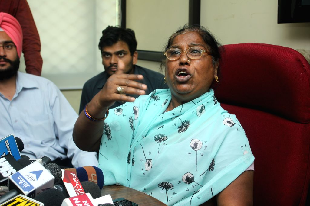 The mother of late Santosh Koli - AAP leader - who was killed in a 2013 road accident addresses press at the office of Delhi Commission for Women in New Delhi, on May 6, 2015.