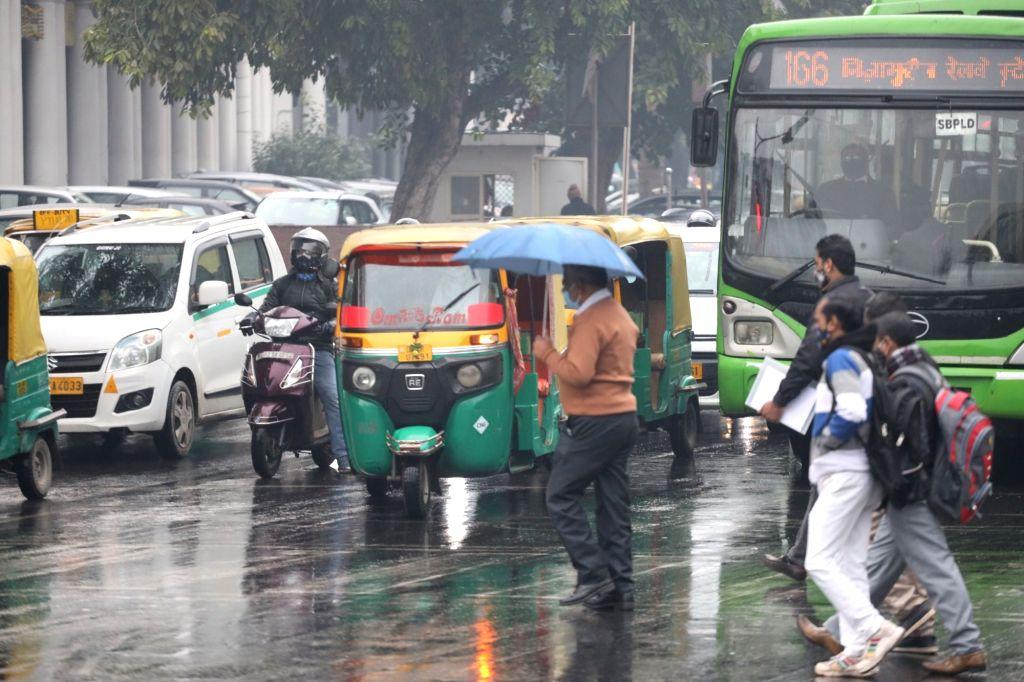 New Delhi: The national capital witnesses rains, on Jan 4, 2021. (Photo: Bidesh Manna/IANS)
