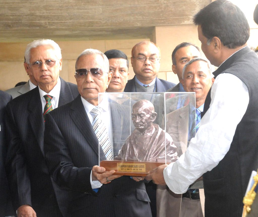 The President of the People's Republic of Bangladesh Md. Abdul Hamid being felicitated during his visit to Rajghat, in Delhi on Dec 18, 2014.