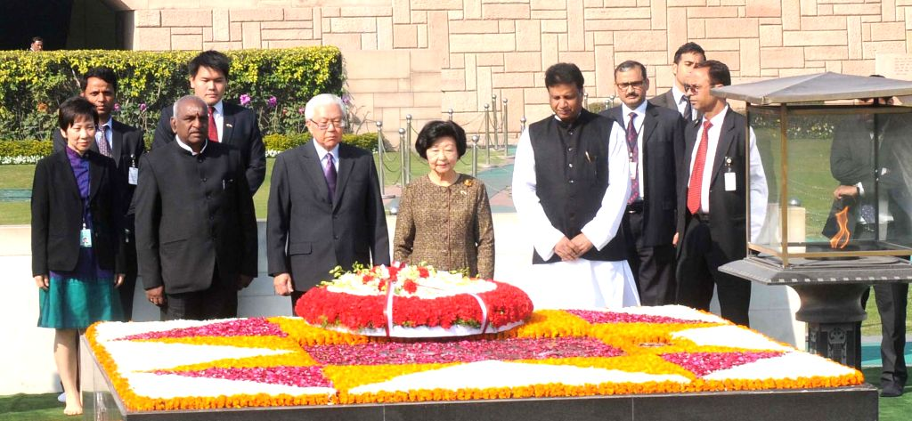 The President of the Republic of Singapore Dr. Tony Tan Keng Yam and Mary Tan pay homage at the Samadhi of Mahatma Gandhi, at Rajghat, in Delhi on Feb 9, 2015. Also seen the Union Minister