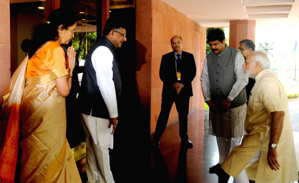 The Prime Minister Narendra Modi arrives at Vigyan Bhavan to inaugurate the `Urja Sangam`, a summit dedicated to energy, in New Delhi on March 27, 2015. Also seen the Union Minister for ... - Narendra Modi