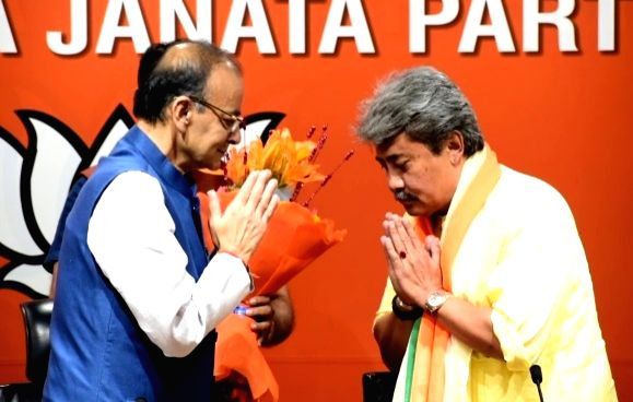 New Delhi: The Sangai Express Publisher and Managing Editor Nishikant Singh Sapam joins BJP in the presence of Union Minister and party leader Arun Jaitley in New Delhi, on April 5, 2019. (Photo: IANS) - Arun Jaitley